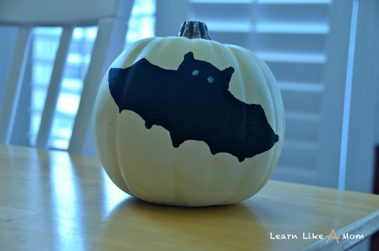 add eyes on bat on pumpkin