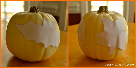 tape stencils to pumpkins