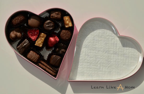 Box of chocolates? Transform it into a game! - Learn Like A Mom! http://learnlikeamom.com/valentines-day-candy-box-games/