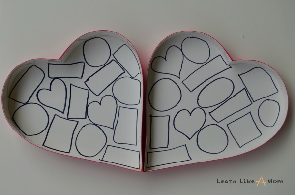Shapes inside a candy box for part of a game! http://learnlikeamom.com/valentines-day-candy-box-games/